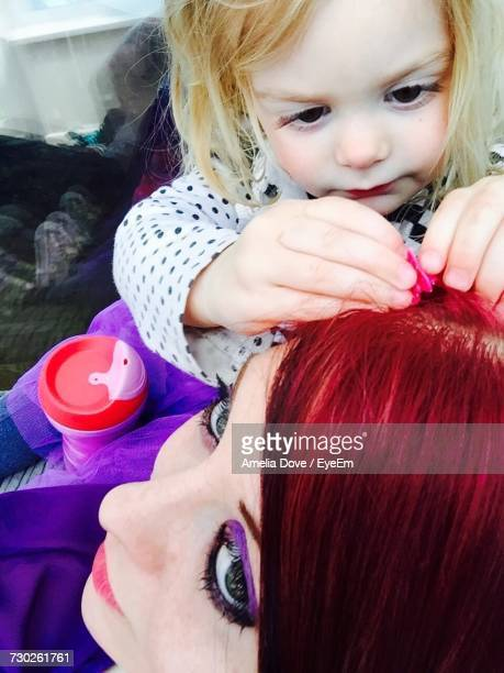 Girl Putting Hair Clip On Mothers Redhead