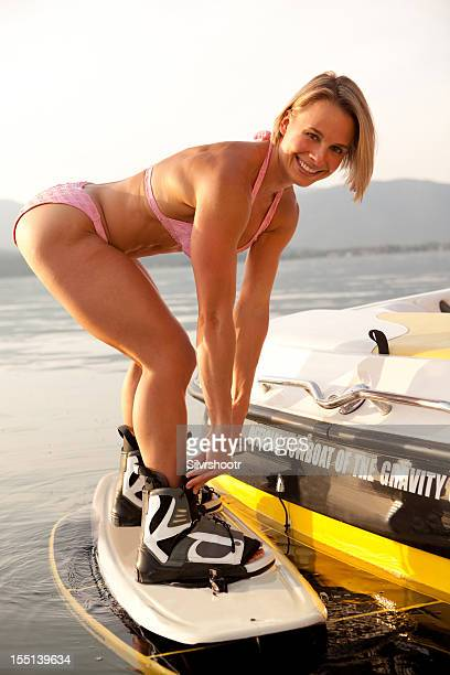 Girl putting on a wakeboard