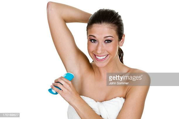 Girl putting on deotorant