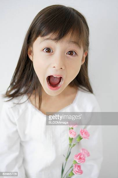 Girl putting on funny expression