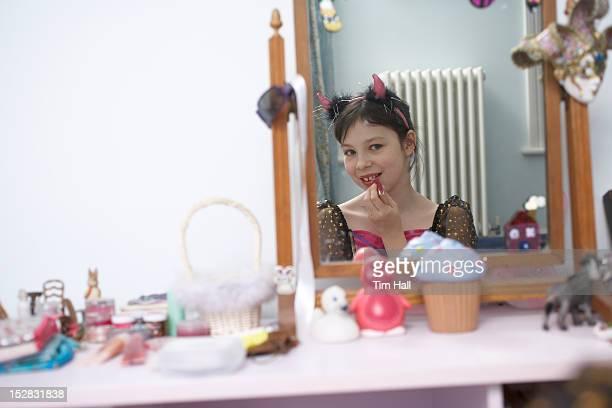 Girl putting on Halloween costume