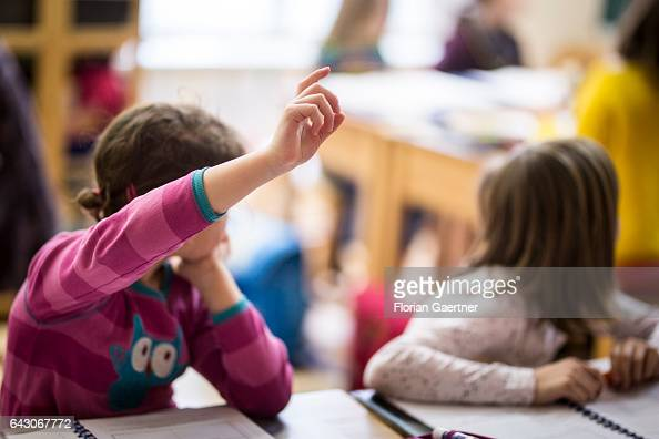 A girl raises her hand during a lesson Feature at a school in Goerlitz on February 03 2017 in Goerlitz Germany
