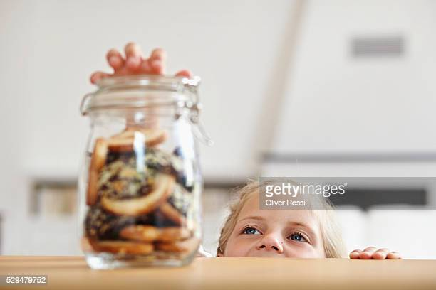 Girl reaching for cookie jar