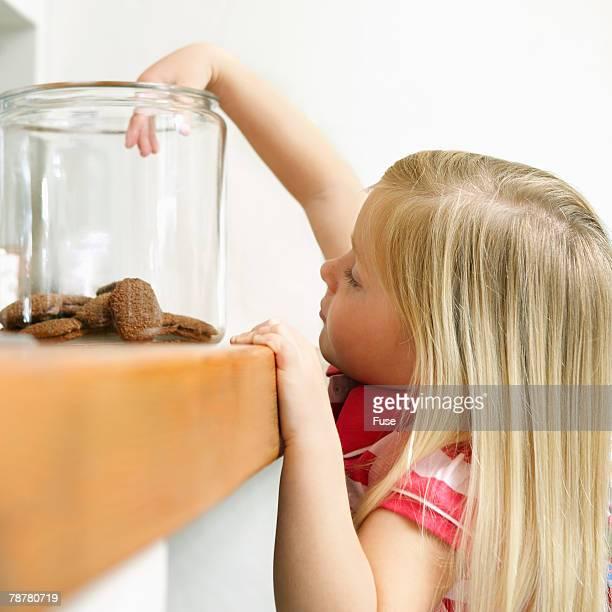 Girl Reaching for Cookies in Jar