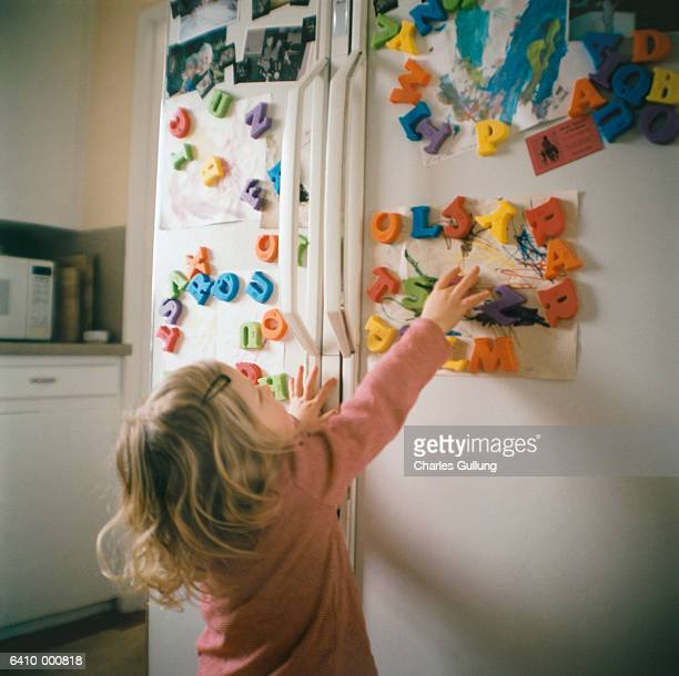 Girl Reaching Letters