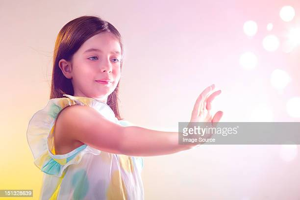 Girl reaching out to lights