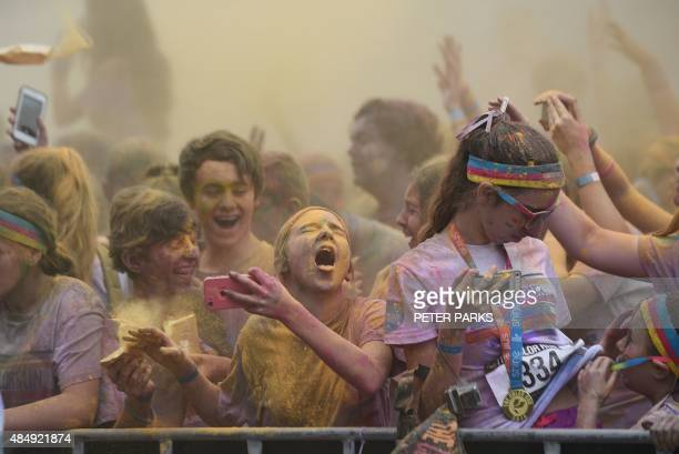 A girl reacts after getting yellow powder in her eys as people participate in the annual Color Run after party in Centennial Park in Sydney on August...