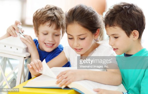 Girl reading a book for friends : Stock Photo