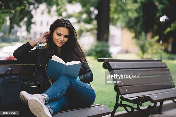 Girl reading a book in the park
