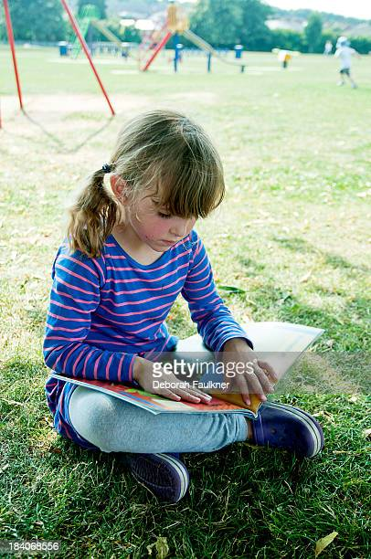 Girl reading at the park