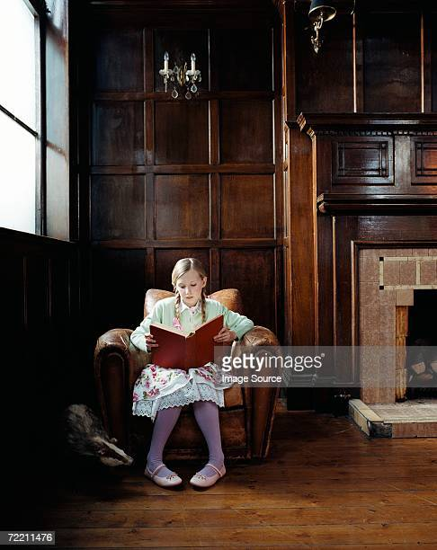 Girl reading beside a badger