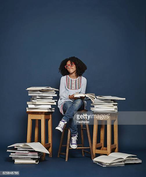 Girl reading lots of books