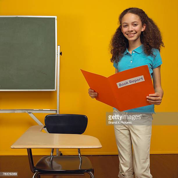 Girl reading report