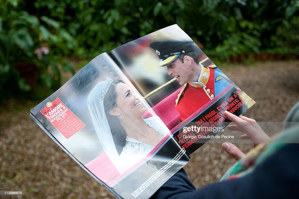 A girl reads an Italian magazine showing photographs of Prince William, Duke of Cambridge and Catherine, Duchess of Cambridge following their wedding, on May 3, 2011 in Rome, Italy. The marriage of the second in line to the British throne was led by the Archbishop of Canterbury and was attended by 1900 guests, including foreign Royal family members and heads of state. Thousands of well-wishers from around the world flocked to London to witness the spectacle and pageantry of the Royal Wedding.