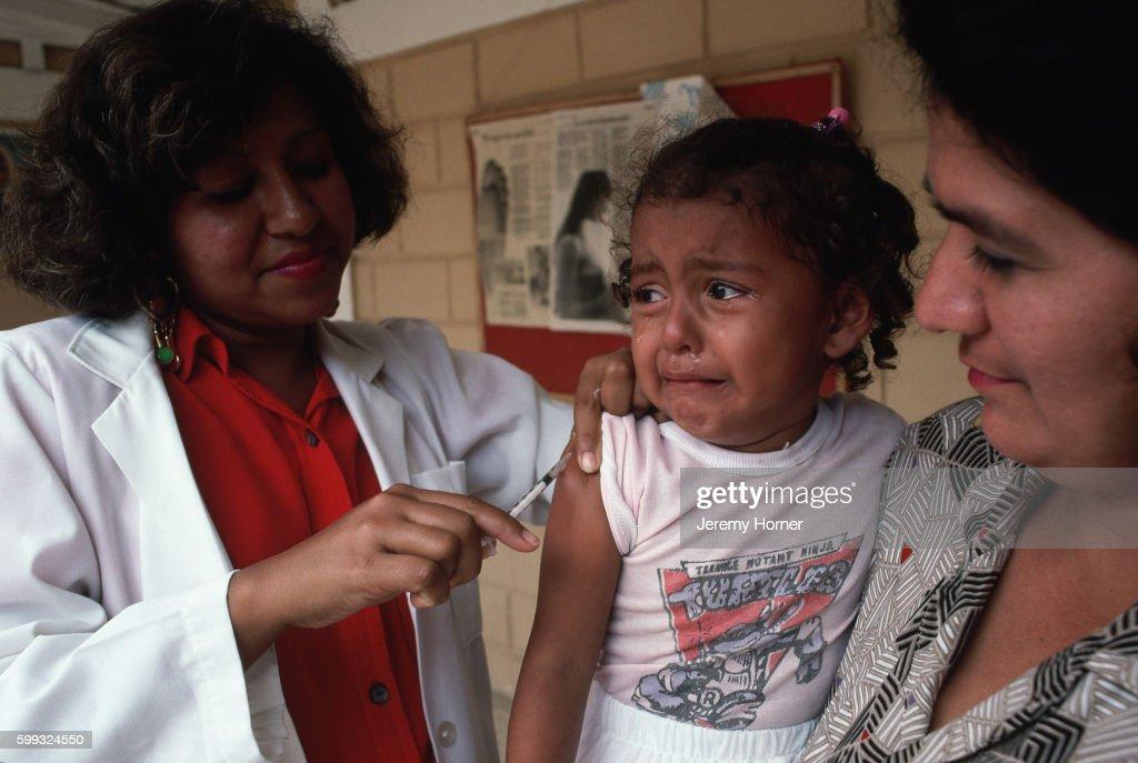 Girl Receives Polio Vaccine : Stock Photo