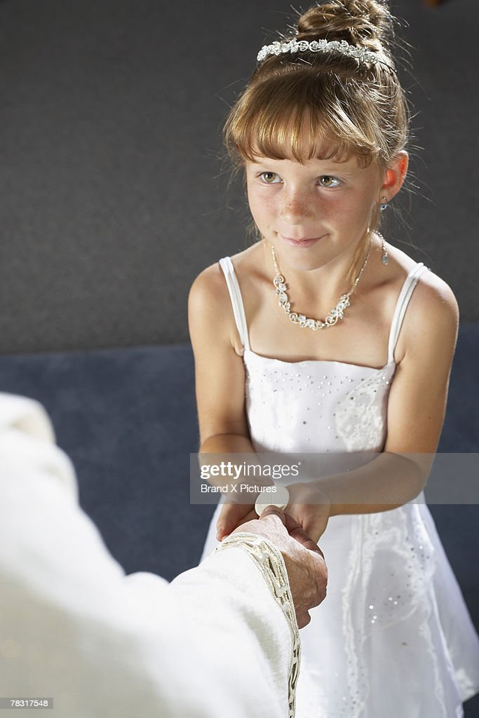 Girl receiving First Communion : Stock Photo