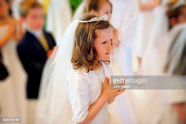 Girl receiving the sacrament of communion