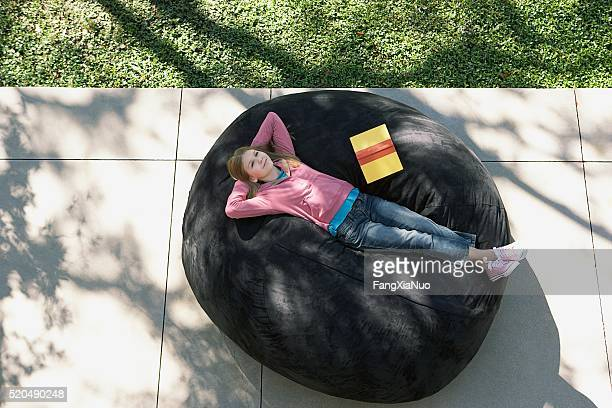 Girl relaxes with a book