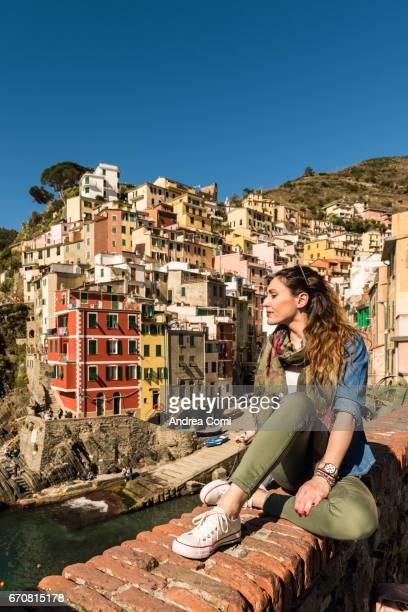 A girl relaxing in Riomaggiore. Cinque Terre, La Spezia, Liguria