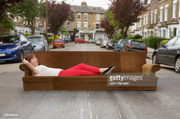 girl relaxing on settee in the street