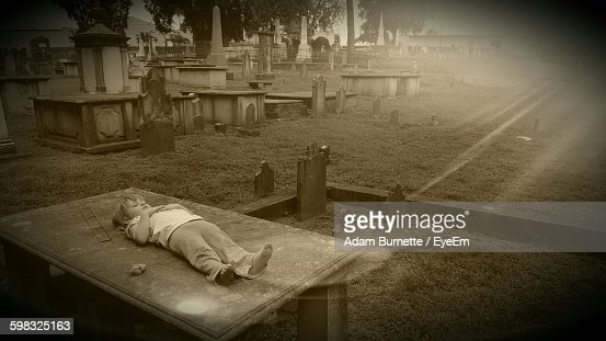 Girl Relaxing On Table At Cemetery