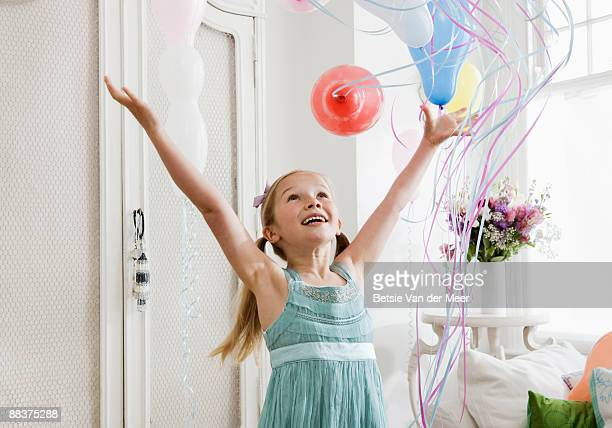 Girl releasing balloons.