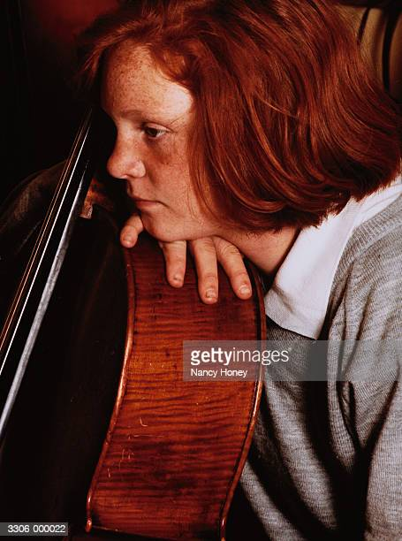 Girl Resting Head on Cello