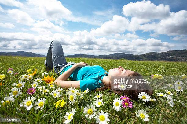 Girl resting in meadow 1