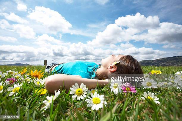 Girl resting in meadow 4