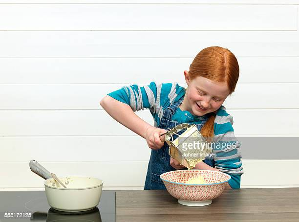 Girl ricing potato for mash