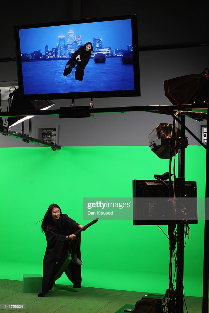 A girl rides a broomstick in front of a green screen at the new Harry Potter Studio Tour at Warner Brothers Leavesden Studios on March 23, 2012 in London, England. The studio, which includes the actual sets and special effects departments where the films were created and shot, goes on public display on March 31, 2012.