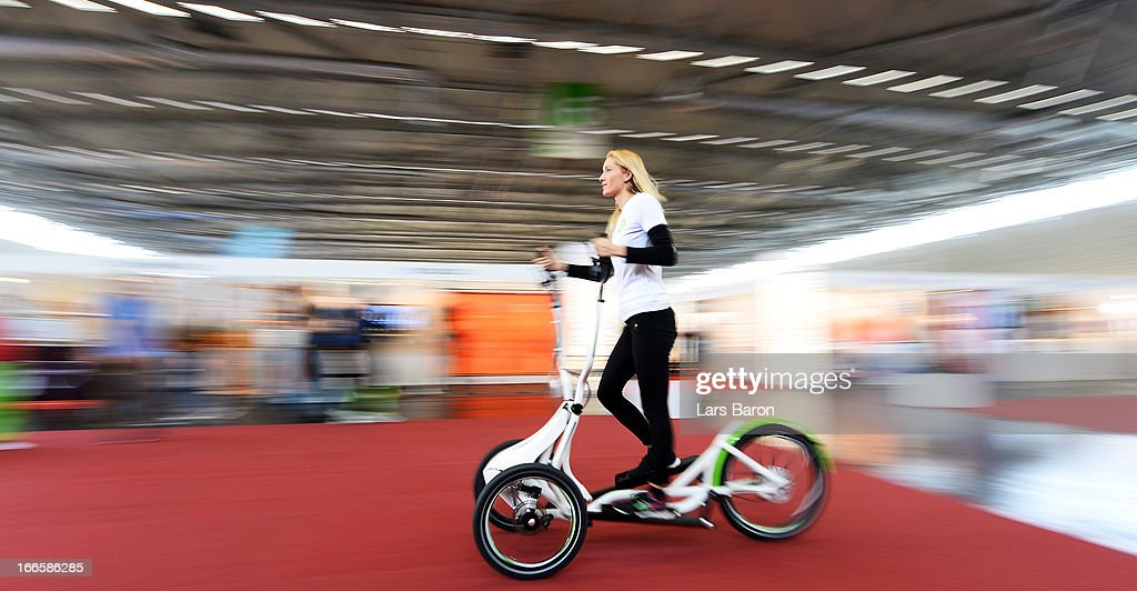 A girl rides a fitness bike during the FIBO 2013 on April 14, 2013 in Cologne, Germany.