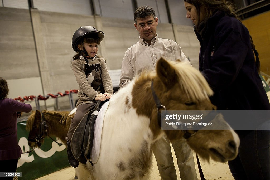 A girl rides a pony during Madrid Horse Week Fair at Ifema on December 23, 2012 in Madrid, Spain.