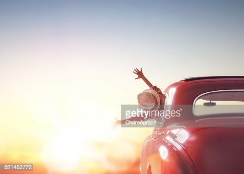 girl rides into the sunset : Stock Photo