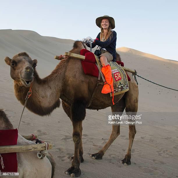 A Girl Riding A Camel