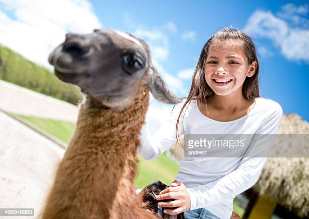Girl riding a llama