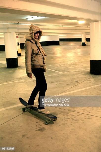 Girl riding a Longboard Skateboard in Empty Lot