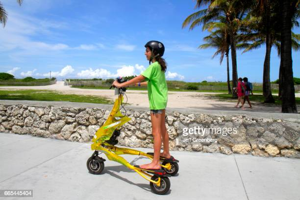 A girl riding a Tribred by Trikke electric vehicle in Lummus Park