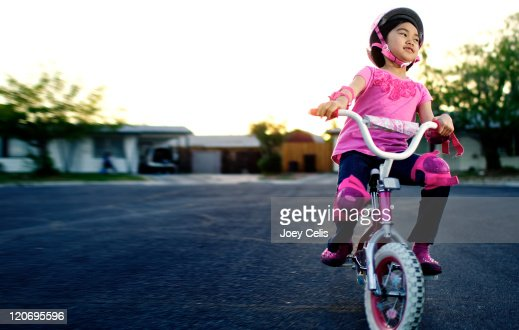 Girl riding bicycle on street