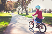 Girl Riding Bike in Park
