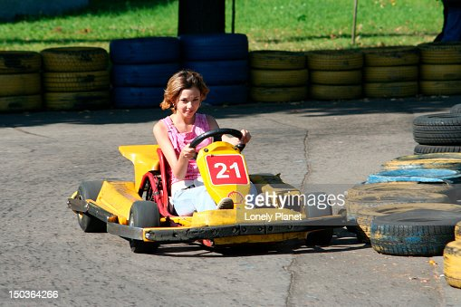 Girl riding go-cart at VDNKh (trade fair and amusement park). : Stock Photo