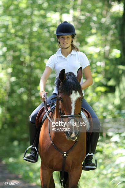 Girl riding in the forest, Norway