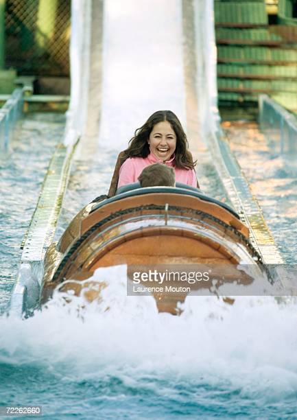 Girl riding log flume