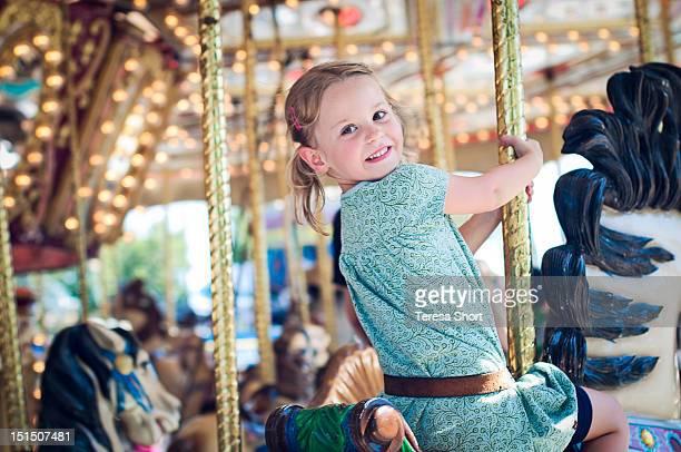 Girl riding on carousel