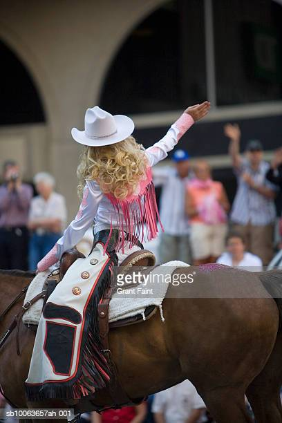 Girl riding on horse at calgary stampede parade