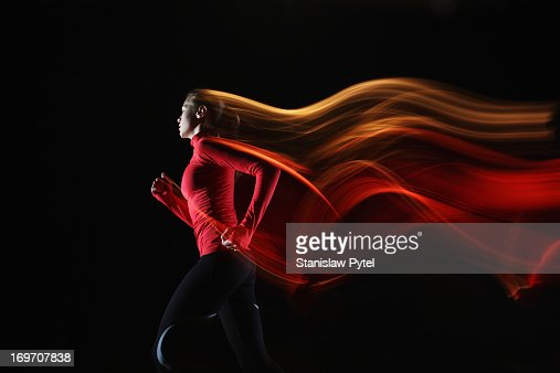 Girl running and leaving light streaks