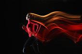 Girl running and leaving light streaks