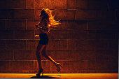 Girl running at the street