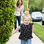 Girl (12-23 months) running away from mother
