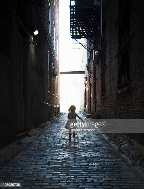 Girl running in alley